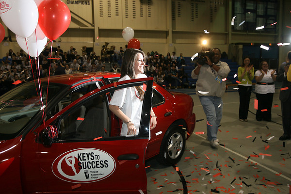 Peabody High School senior Linda Pratto is showered in confetti as she steps out of her brand new car which she won in the Keys To Success program on Friday afternoon. David Le/Staff Photo