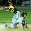 Manchester-Essex second baseman Ryan Garlitz, left, and Danvers American runner Jackson Leete, right, both look over at the umpire to get the call on a close play at second base. David Le/Staff Photo