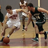 Marblehead's Phil Coughlin, left, and Pentucket's Nolan Dragon battle for a loose ball. David Le/Staff Photo