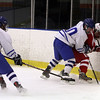 Salem: Danvers captain Joe Strangie (10) center, staples a Saugus player to the boards as fellow captain JD Hodgkins (16) sweeps in to steal the puck. David Le/Salem News