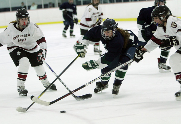 Pingree alternate captain Lily Sabatini fights through two Portsmouth Abbey defenders on Friday night. David Le/Salem News