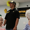 Peabody: Boston Bruins forward prospect Ben Sexton calls out bingo numbers to patients at the Pilgrim Rehabilitation Center in Peabody on Friday afternoon. 8 Bruins players came to play Wii games, bingo and air hockey with 30 patients. Photo by David Le/Salem News