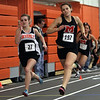 Marblehead's Kelly Roland (197) right, and Beverly's Theresa Orr (27) compete in the 300m race on Wednesday. David Le/Salem News