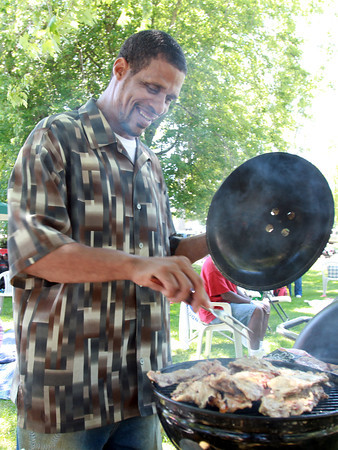 "Vincent Bowles, of Memphis, TN, grills up some ""Tennessee Style"" meat at the Annual Black Picnic at Salem Willows on Saturday afternoon. David Le/Staff Photo"