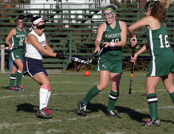 Swampscott's Cody Kline, left, battles for an airborne ball with Manchester-Essex players Mel Moore (40) and Ellen Burgess (16) on Wednesday afternoon. David Le/Salem News