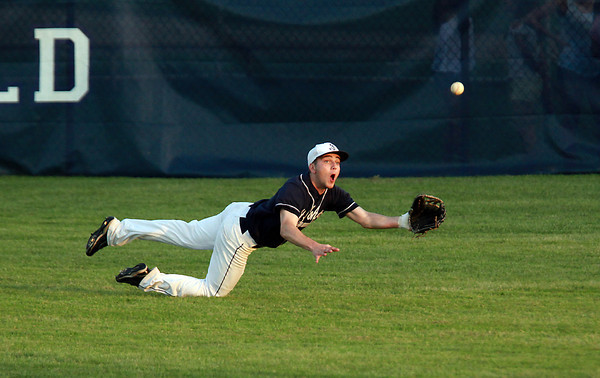 St. John's Prep centerfielder Nick Sadler lays out to make a diving catch, ending the inning and stranding two Danvers runners on base. David Le/Staff Photo
