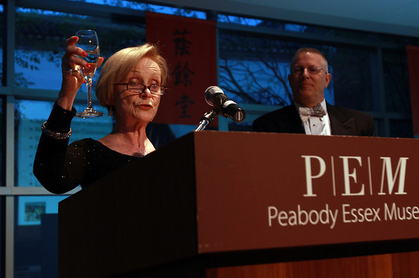Sandy Heaphy, President of the Salem Chamber of Commerce, offers a toast at the start of the Chamber of Commerce 100th Anniversary Celebration at the Peabody Essex Museum on Wednesday night. David Le/Staff Photo