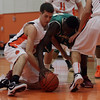 Beverly: Beverly's Dan Cacciatore, left, and Lynn Classical's Uche Nwokeji right, battle for a loose ball on Tuesday night.  David Le/Salem News