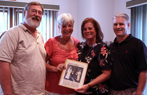 Peabody: Salem sisters Robin Hincman, middle left, and Renee Dempsey, middle right, married two best friends, Paul Hincman, left, and Dana Dempsey in a double-wedding ceremony. 35 years later the four of them are still inseparable. Photo by David Le/Salem News