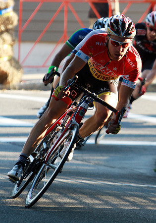 Beverly's Shawn Milne leads a group of racers in the Men's Elite Race through a hairpin turn near the Beverly Public Library during the 4th Annual Beverly Gran Prix on Wednesday evening. David Le/Staff Photo