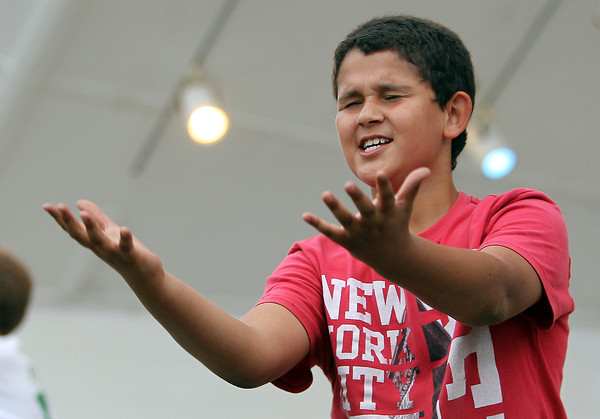 "Alexi Echevarria, 10, of Beverly, dances along to ""You Raise Me Up"" by Josh Groban during the annual Beverly Homecoming Lip Synching Competition in the half shell at Lynch Park. David Le/Staff Photo"