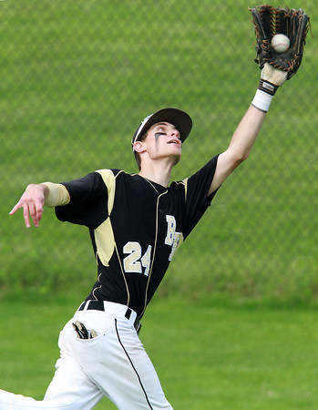Bishop Fenwick right fielder Joe Levassuer, lunges to snag a fly ball to end the third inning of play against St. John's Prep on Wednesday afternoon. David Le/Staff Photo