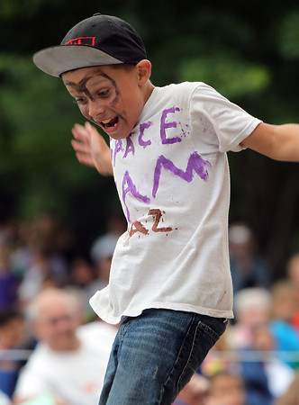 Joseph Hutchinson, 8, of Beverly, dances along to the music from Space Jam on Tuesday evening during the annual Beverly Homecoming Lip Synching Competition.  David Le/Staff Photo