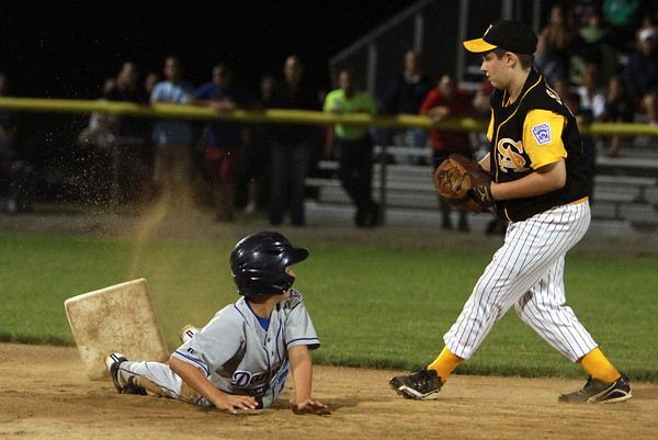 Danvers American runner Matt Reidy slides safely into second base before Saugus shortstop Jimmy Alcott could apply the tag. David Le/Staff Photo