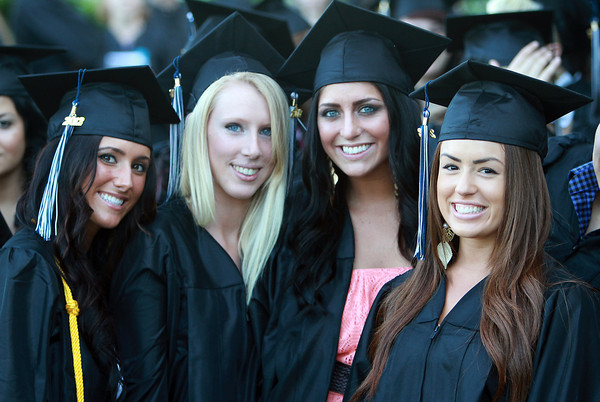 North Shore Community College soon-to-be graduates from left, Christina Makridis, Sabrina Smith, Megan Schwartz, and Maria Bechman, pose for a photo before marching into the O'Keefe Center for their Commencement Ceremony on Thursday evening. David Le/Staff Photo<br /> &#x03;, North Shore Community College soon-to-be graduates from left, Christina Makridis, Sabrina Smith, Megan Schwartz, and Maria Bechman, pose for a photo before marching into the O'Keefe Center for their Commencement Ceremony on Thursday evening. David Le/Staff Photo<br /> &#x03;