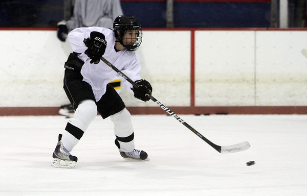 Peabody: Bishop Fenwick's PJ Usalis passes the puck up-ice to a teammate during practice last week. David Le/Salem News