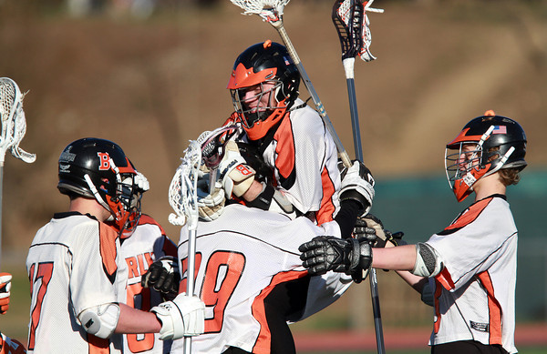 The Beverly Panthers Boys Lacrosse team celebrates their win over Hamilton-Wenham on Friday afternoon. David Le/Staff Photo