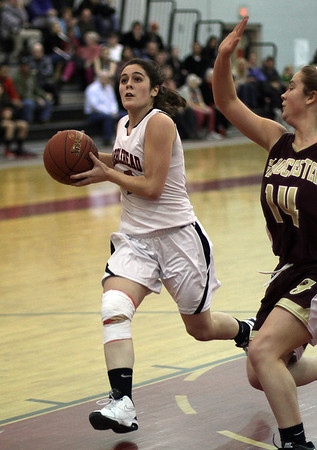 Marblehead's Kathryn DiGiammarino (2) left, drives into the paint for a layup. David Le/Salem News