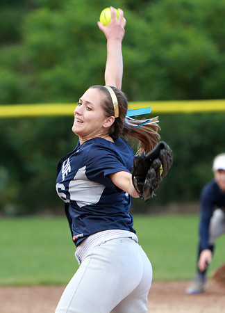 Swampscott starting pitcher Angela Vousboukis winds up and unleashes a strike against Newburyport on Tuesday evening. David Le/Staff Photo
