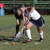 Swampscott High School's Lisa Vu carries the ball upfield while being pressured by a Manchester-Essex defender. The Hornets defeated the Big Blue 3-2 on a last minute goal in the first round of the state tournament on Wednesday in Swampscott. David Le/Salem News