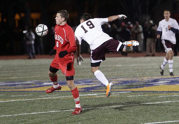 Masco junior Charles Sherman (6) plays the ball while being pressured by Ludlow's Sukru Yldirim. David Le/Salem News