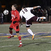 Masco junior Charles Sherman (6) plays the ball while being pressured by Ludlow's Sukru Yldirim. David Le/Salem News