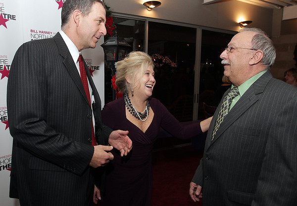State Representative Jerry Parisella, left, and his wife Lisa, chat with Jerry Guilebbe, Veterans Agent for the City of Beverly, at a homecoming party held at the North Shore Music Theater on Tuesday night. David Le/Salem News