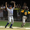 Danvers American first baseman Nick Raimo, left, pumps his fist in the air after he caught the final out at first base and sealed a 10-8 win for Danvers over Manchester-Essex on Thursday evening at Harry Ball Field in Beverly. David Le/Staff Photo