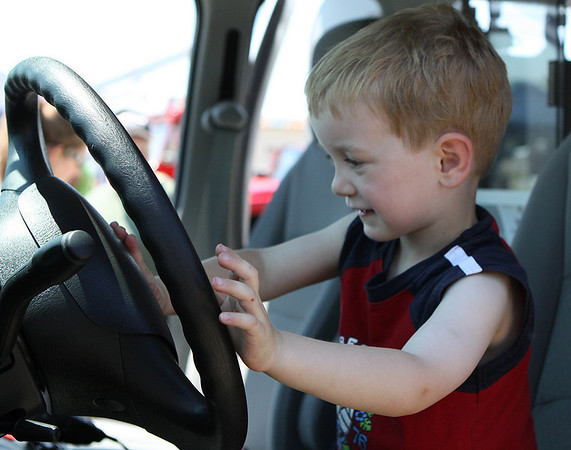 Danvers: Jedidiah Bell, age 3 of Salem, honks the horn of an ambulance at the Touch-A-Truck Day held at the Liberty Tree Mall in Danvers on Saturday morning, as part of the Danvers Family Festival. Photo by David Le/Salem News