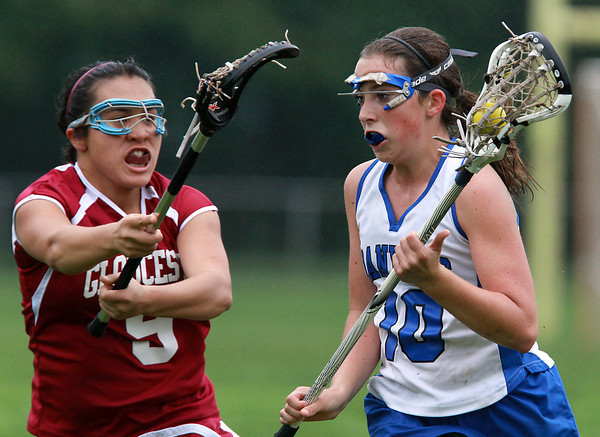 Danvers sophomore Rachel Trocchi, right, drives to the net against Gloucester's Anna Oshiro, left. The Falcons defeated the Fishermen 13-11 on a misty Tuesday afternoon. David Le/Staff Photo