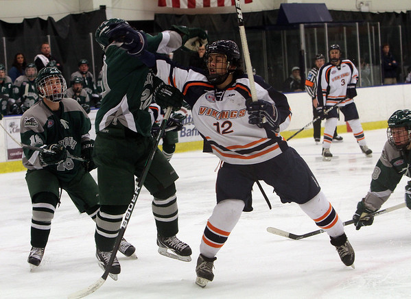 Salem State's Nick Lampson (12) right, and Plymouth State's Kyle Ross (20) left, collide as they battle for a puck that popped up in the air. David Le/Salem News