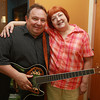 Cindi Potter, right, of Beverly, poses with musician Charlie Dawson, of Salem, after he performed at the Beverly Senior Center for a Father's Day Part on Tuesday morning. David Le/Staff Photo