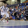 Peabody's Mike Gould races down-court on a breakaway against Winthrop on Friday night. David Le/Salem News