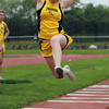 Bishop Fenwick senior Eileen Delory goes airborne during the long jump on Tuesday afternoon. David Le/Staff Photo