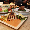 A few of the daily specials are displayed on a counter at Red's Kitchen and Tavern. David Le/Staff Photo