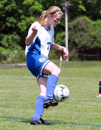 Danvers Girls U-14 Tornados player Erin St. Pierre controls the ball against Woburn on Monday morning. David Le/Staff Photo
