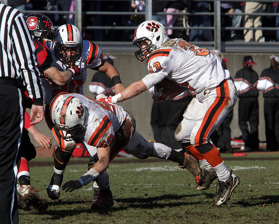 Beverly runningback Brendan Flaherty (33) uses the blocks of Blake Sullivan (50) and Nick Theriault (20) and rushes for a big gain against Salem on Thursday morning. David Le/Salem News