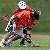 Beverly center John Page scoops up the ball after winning a faceoff against Salem on Thursday. David Le/Staff Photo