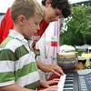 Conor Clyne, 7, of Salem, and Brian Cogger, 18, of Topsfield, play a song together on the keyboard at the Salem Jazz and Soul Festival on Saturday afternoon. David Le/Staff Photo