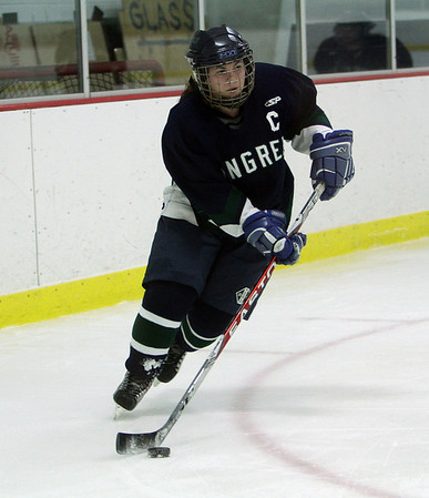 Pingree captain Shelby DiFiore carries the puck in the offensive zone. David Le/Salem News