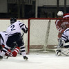 Peabody goalie Joe Powers looks back to find the puck in his net against Saugus on Wednesday night. David Le/Salem News
