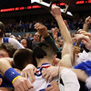 Danvers senior captain George Merry hoists the D3 State Championship trophy high for all of Danvers Nation to see as he is engulfed in the hugs of Danvers fans that made the trip to the DCU Center in Worcester to see the Falcons bring home the State Title. David Le/Staff Photo