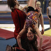 Yellowjackets instructor Tim Kormann, left, helps Jennifer Forde, right, with a back flip. David Le/Staff Photo.