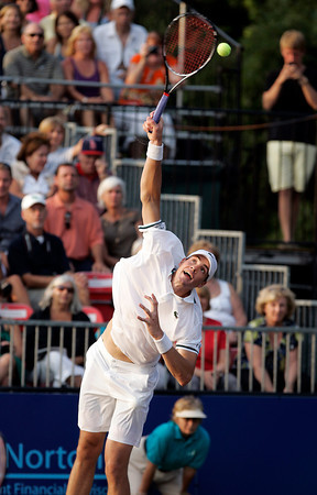 Boston Lobsters star John Isner smashes a serve against the Philadelphia Freedoms on Monday evening before departing to a standing ovation for the Olympic Games in London. David Le/Staff Photo