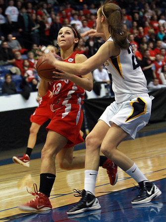 Masco senior Taylor Evans (13) left, drives into the lane against Andover's Nicole Boudreau (25) right during the D1 North Final on Saturday afternoon. David Le/Staff Photo
