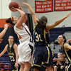 Salem State's Ginny Fleming (32) left, hoists up a shot as USM's Haley Jordan (31) provides pressure. David Le/Salem News
