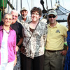 From left, Judy and Tom DesFosses, John Newman, rigger and mate on the Friendship, Colleen Bruce, of the National Park Service, Jeremy Bumagin, Captain of the Friendship, and Stacy Diedrich, of Rockland, pose for a photo at a retirement party for Bruce aboard the Friendship on Friday evening. David Le/Staff Photo