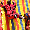 Danvers: Jacob Palhares, age 6 of Peabody, sticks to the velcro wall after taking a flying leap while Tyler Navarro, age 4 of Danvers watches in amusement at Endicott Park Day held on Saturday afternoon in Danvers. Photo by David Le/Salem News