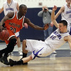 Danvers senior captain Jon Amico draws an offensive foul after Wayland's Robert Williams pushed him over. David Le/Staff Photo