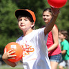 Artworks at Waring camper Nick Woods, 11, of Beverly, plays dodgeball on Wednesday afternoon on the quad of the Waring School. David Le/Staff Photo